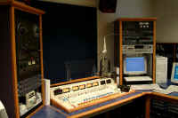Production room studio furniture.  Broadcast console and rack equipment shown.