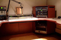 Production studio furniture.  Small studio for radio production.  We flush mount a variety of broadcast consoles and audio production consoles to meet your needs.