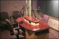 Talk studio table.  An example of a studio furniture table in a radio station. The talk table houses the broadcast equipment necessary for their on air interviews.