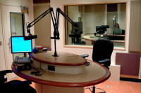 This studio is a talk studio in a major university radio station. The talk studio furniture enables the radio station to conduct controlled on air interviews while maintaining open visual contact with the guests while on air.