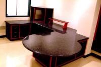 Bold corian studio furniture.  This on air studio has Corian worksurfaces.  We custom design and manufacture studio furniture for all your broadcasting and multimedia environments.